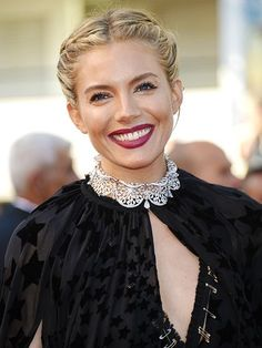 2015 Cannes Film Festival - Sienna Miller's French braided middle-part updo with flirty eyelashes and berry lipstick | allure.com