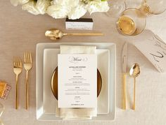 Wedding menus and table number cards add an elegant touch to your wedding reception tables. Glitz your day up with gold utensils!