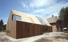 Amsterdam's architecture firm SeARCH has put a really modern twist on this farmhouse renovation in Zutphen, Netherlands. Roof Cladding, Larch Cladding, Barn House Design, Roof Design, Wooden Facade, Timber Roof, Contemporary Barn, Contemporary Architecture, Best Barns