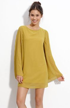 Mustard long sleeve dress.  This would be super cute with boots!