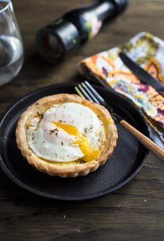 Fried Egg Quiche- Rich quiche, with a savory custard, filled with bacon and gruyere cheese and on top a fried egg to pump up the protein level.