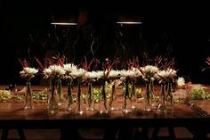 We decorated the tables with spider mums in Ikea vases. We loved the wooden letters glued to to sticks (with our initials, of course). We also used hops to decorate the table. Perfect for a beer-loving groom.