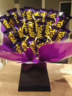 This Cadbury Twirl Bouquet is packed full of yumminess! With 24 double bars of Twirls, this is sure not to disappoint. This bouquet comes complete with cellophane and tissue paper decoration and an ivory/purple ribbon bow. All of the chocolate bars are secured without any damage to the chocolate Milky Bar Chocolate, Chocolate Bars, Melting Chocolate, Purple Ribbon, Ribbon Bows, Cadbury Twirl, Tissue Paper Decorations, Mum Birthday, Birthday Ideas