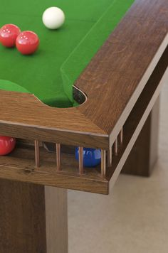 This handsome snooker table made from fumed oak makes a striking visual feature . This handsome snooker table made from fumed oak makes a striking visual feature of the ball rails.