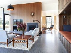 Grand Designs Australia- polished concrete floors with stones, recycled wood on nook, recycled basketball flooring, hanging lights, starburst clock. Make the lounge room sunken and you have a winner! Grand Designs Australia, Mod Living Room, Casa Top, Polished Concrete Flooring, Cement Floors, Rammed Earth Homes, Latest House Designs, Concrete Kitchen, Living Room Designs