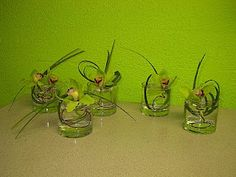And let's not forget the cocktail tables, lily grass for movement, green orchids attached with red wire.