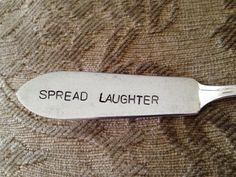 """vintage butter knife, cheese spreader. Hand Stamped with the words """"Spread Laughter"""""""