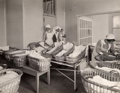 Nurses with babies at the Elsie Inglis Memorial Maternity Hospital, 1930s UK