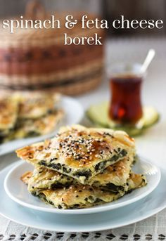 Spinach and Feta Borek: A classic Turkish recipe. Layers of phyllo dough sheets … Spinach and Feta Borek: A classic Turkish recipe. Layers of phyllo dough sheets flavored with spinach and feta cheese. food feta Spinach and Feta Cheese Börek Middle Eastern Dishes, Middle Eastern Recipes, Middle Eastern Vegetarian Recipes, Middle Eastern Bread, Turkish Recipes, Greek Recipes, Romanian Recipes, Scottish Recipes, Borek Recipe