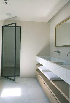 Calm bathroom by Belgian office AIDarchitecten. I'm a sucker for slim, black steel door frames. They always add a sense of classical elegance to a modern interior.