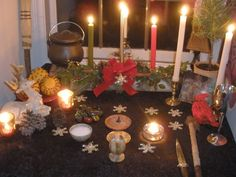 Another lovely Yule altar.  I love the cloved orange offerings.