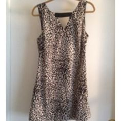 Animal print shift dress Shift dress by Sugarlips V-neck with cut out in back. Silky date night dress. NWOT Sugar lips Dresses