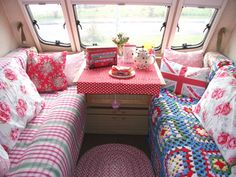 Cath Kidston style caravan. Love pink and red together. Love the colors in the afghan. And I have those vintage rose pillowcases which makes me think I need to do something like this with them.