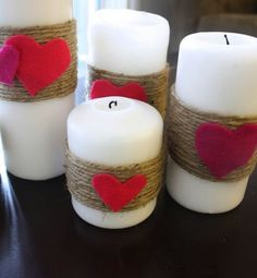White Pillar Candles with twine wrap and hot-glued hearts. Fast, easy and so cute!