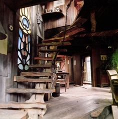 An image from the book 'Artist's Handbuilt Houses'  - staircase would never pass code here, but it does look intriguing