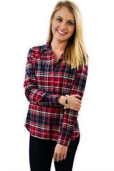 Flannel Piko - $36.95 - Flannel Piko Top with great colors of red with blue and even green stripes in the flannel pattern. Now days Piko style tops are all the rage and what can be better than having a flannel piko!  | available at https://www.envyboutique.us/product/flannel-piko/ |  #Envy #Boutique #fashion #fashiontrends
