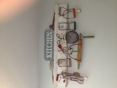 Old vintage wooden and wire kitchen utensils on display as art/ decoration