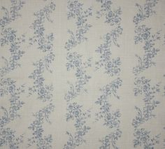 Daphne Linen Fabric A graceful floral linen fabric with flowing vines of china blue roses.