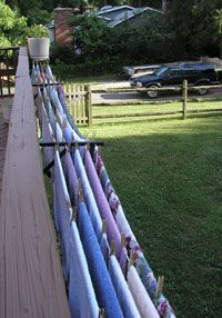 Convenient Outdoor Clothesline Each section dries approximately 1 large load of laundry. This deck has 5 brackets with 4 sections of clothes line. Each section is gives you about 30' of clothes line. (6' on center from post to post x 5 lines = 30')