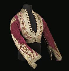 A LADY'S JACKET OF RED VELVET Albania or Serbia, CENTURY the deep red velvet ground densely embroidered in gilt thread, with knotted cylindrical, coral bead tipped decorative buttons (Pharyah) Historical Costume, Historical Clothing, Vintage Outfits, Vintage Fashion, Vintage Costumes, Ethnic Dress, Period Outfit, Folk Costume, Larp