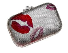 Steal some kisses with this Judith Leiber minaudière. Inspiration for clutch William gives to Huntley.