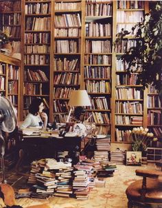 Nigella's library. I would never leave this room. Check out the Sound of Music record on the floor by the flowers. Fabulous!
