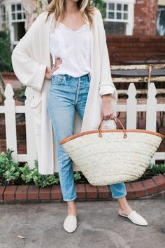 This oversized market basket is hand-woven from palm fronds and trimmed with cognac leather—perfect for and afternoon out.