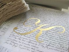 Gold Monogram on French script paper