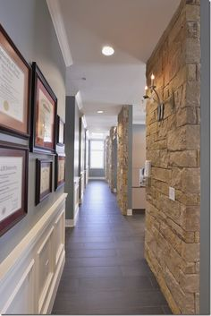 Brick veneer adds interest and warmth to long corridor. A Welcoming office. Greys, tans, browns, and cream. Law Office Design, Dental Office Decor, Medical Office Design, Healthcare Design, Dental Offices, Design Offices, Office Fun, Office Designs, Office Gifts