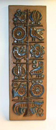 Plaque by Marianne Starck; approximately 17 x 4½ in.