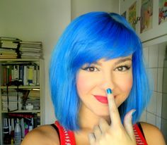 bright blue hair with side swept fringe  Not crazy about the bangs for myself but they're cute on her!