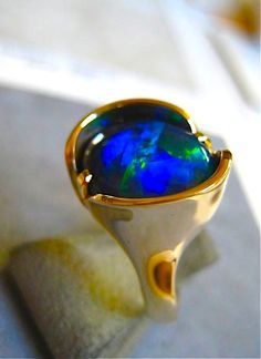 Lightning Ridge Black Opal ring. Just finished yesterday and ready for sale by Glenn Dizon. Size about 7 and can be sized 1.5 sizes either way. Opal 5.97 carats. Slightly angular dependent but gorgeous. $4975. This needs to be on your finger!