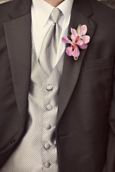black suit, grey vest. like this for the groomsmen... groom wearing all grey.