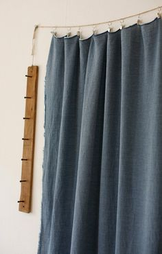 Use twine to hang curtains in the laundry room instead of a tension rod. Hmmm.