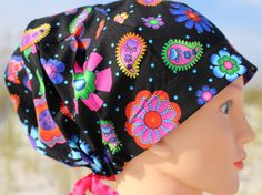 Black with Bright Flower Paw Print Womens Scrub by SharrisCuteCaps