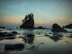 Picture of a meteor shooting across the sky over Second Beach in Washington State. Photograph by Craig Goodwin