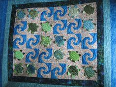 "Love this turtle snail's trail quilt!  just photo, no pattern.  For pattern, google ""Hanu Sea Turtle quilt"""
