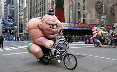 People riding bicycles make their way down 6th Avenue during the 89th Macy's    Thanksgiving Day Parade in the Manhattan borough of New York   Click    here to see more Macy's Thanksgiving pictures