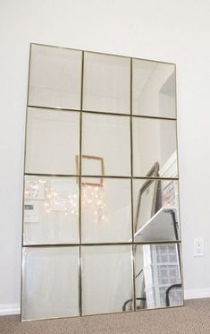 Grab Dollar Store mirrors and duct tape for this high-end decor