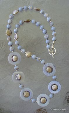 """20"""" beaded necklace. Shell & glass."""