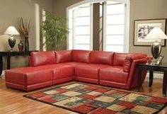 Max Furniture Kayson Sectional Sofa  Fabric: Leather  Cushion Fabric: Red  Plush overstuffed cushions  High polyester fiber filled back & deep modern tufted look seat cushions  Rich, bonded leather  http://www.maxfurniture.com/detail-Living-Room-Seating-Kayson-Sectional-Sofa-188-40237.aspx