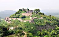 The torrential Banganga River deep in the valley forming a formidable sheer and the Kangra Fort lurking atop the flat mountain range is a scene that one encounters on nearing Kangra town when you drive from Shimla-Mataur national highway.