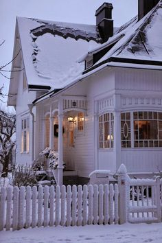 Pretty white cottage in the snow! I love the details of the house!