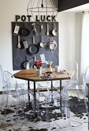 Get inspired by this vintage industrial dining room   www.vintageindustrialstyle.com #vintageindustrialstyle #industrialdiningroom #industriallamps