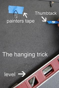 Grab piece of Painter tape, put a thumbtack through the center. The thumbtacks should be pointing toward the wall. Then put it underneath the hooks for hanging your frame or picture. Place the frame where you want it to go on the wall. Use a level to make sure it is straight. Once it is positioned in place, push on it and the tacks will go into the wall telling you where to place your nails.