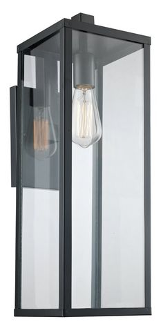 The Pinon wall lantern showcases any outdoor living space with both style and functionality. The durable craftsmanship is inspired by industrial design themes and maintains a distinctive look as it provides accent and area lighting. The Pinon collection makes a dramatic statement, with elongated clear glass panels on each side, a centered single down light and understated black metal frame.