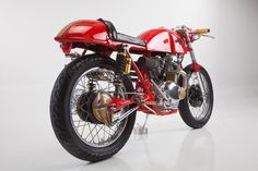honda 305 cafe racer | Up front are custom fabricated aluminum clip-on bars with wood grips ...