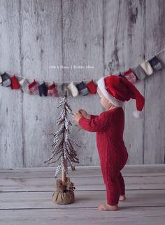 child Santa decorating christmastree
