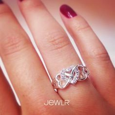This design changes the traditional infinity symbol to display 2 hearts on the sides, interlocked with a third shiny heart in the center. It represents unconditional love that will last forever. Have this item custom made with genuine diamonds or your favorite Swarovski Zirconia stone and add an engraving to make this ring the perfect gift for your special someone.