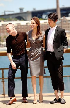 Her glamorous side ... Jolie at Sydney Harbour with the film's stars Jack O'Connell (left